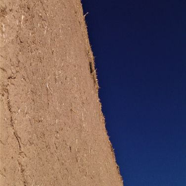 Mud stucco over adobe